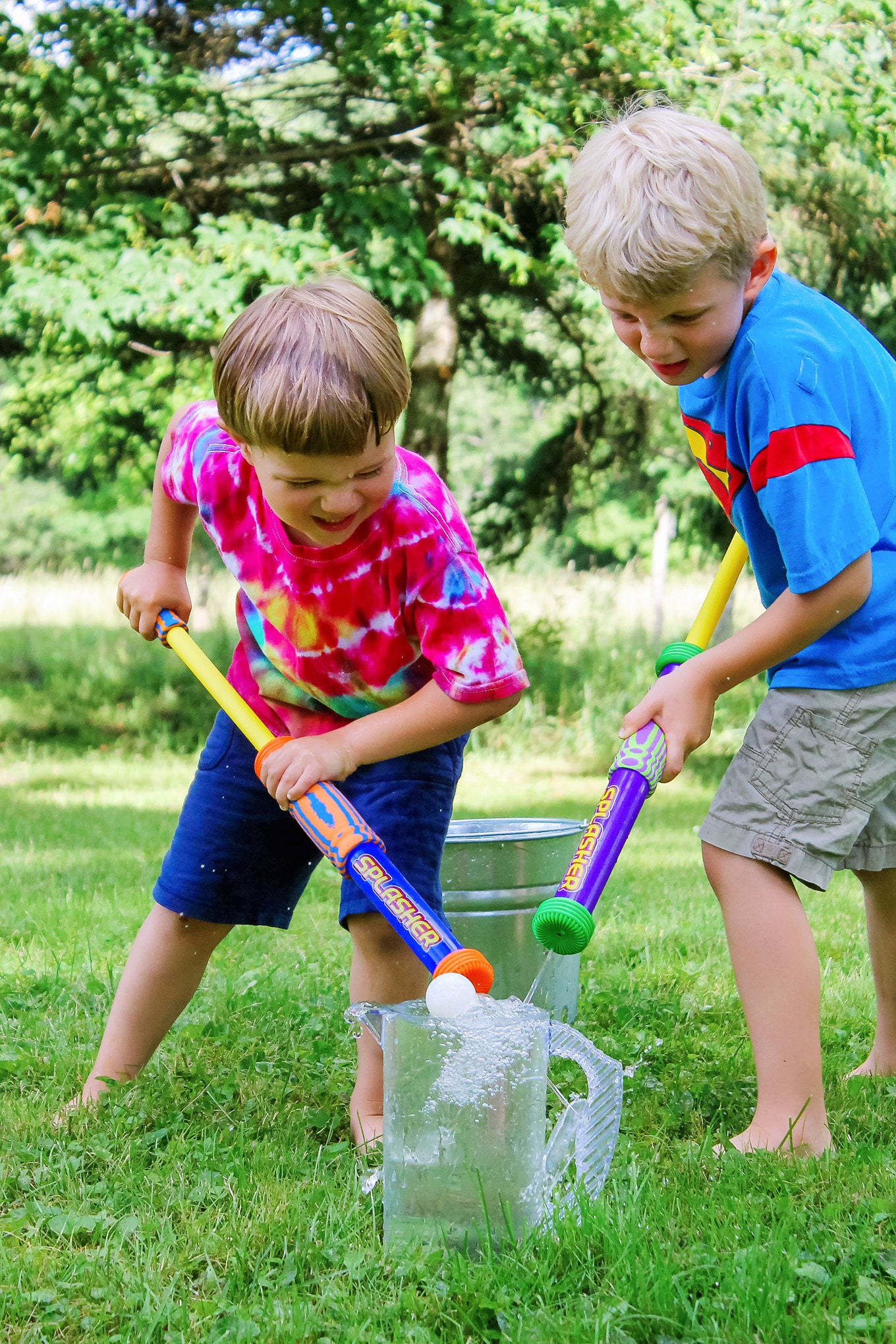 Two Kid Playing Water Blaster Games