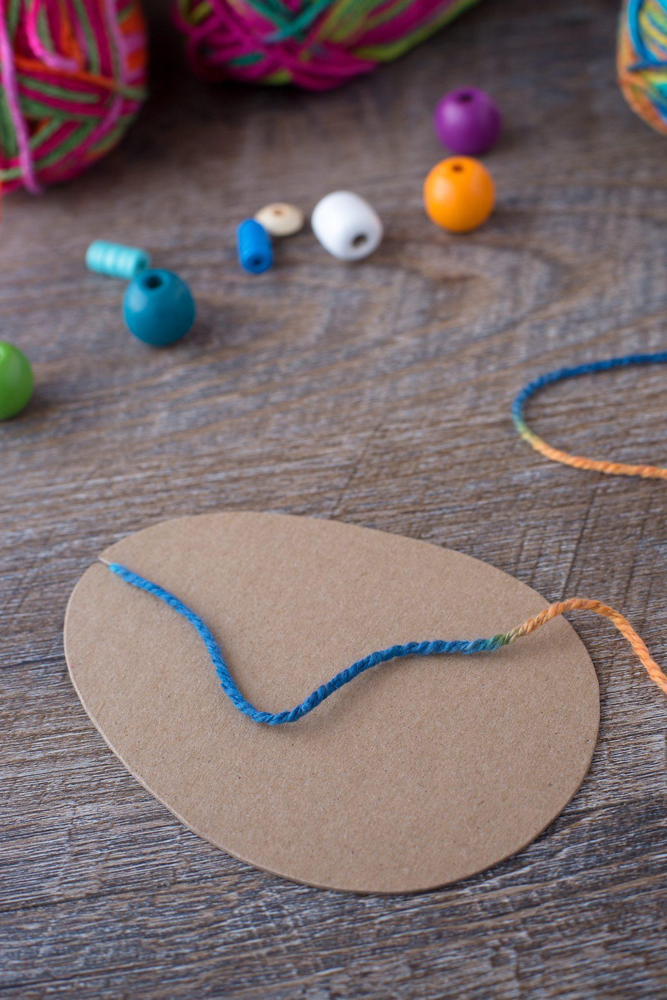Blue Yarn on Cardboard Easter Egg