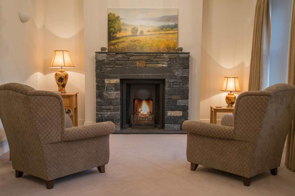Slate fireplace with open fire