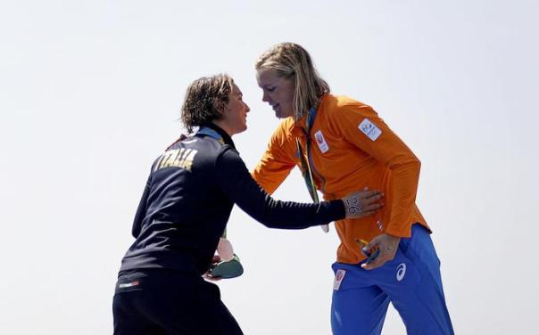 Gold medalist Sharon van Rouwendaal, of the Netherlands, right, embraces silver medalist Rachele Bruni, of Italy, on the podium after the women's marathon swimming event at the 2016 Summer Olympics in Rio de Janeiro, Brazil, Monday, Aug. 15, 2016. (ANSA/AP Photo/David Goldman) [CopyrightNotice: Copyright 2016 The Associated Press. All rights reserved. This material may not be published, broadcast, rewritten or redistribu]