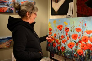 Nanci painting Poppies
