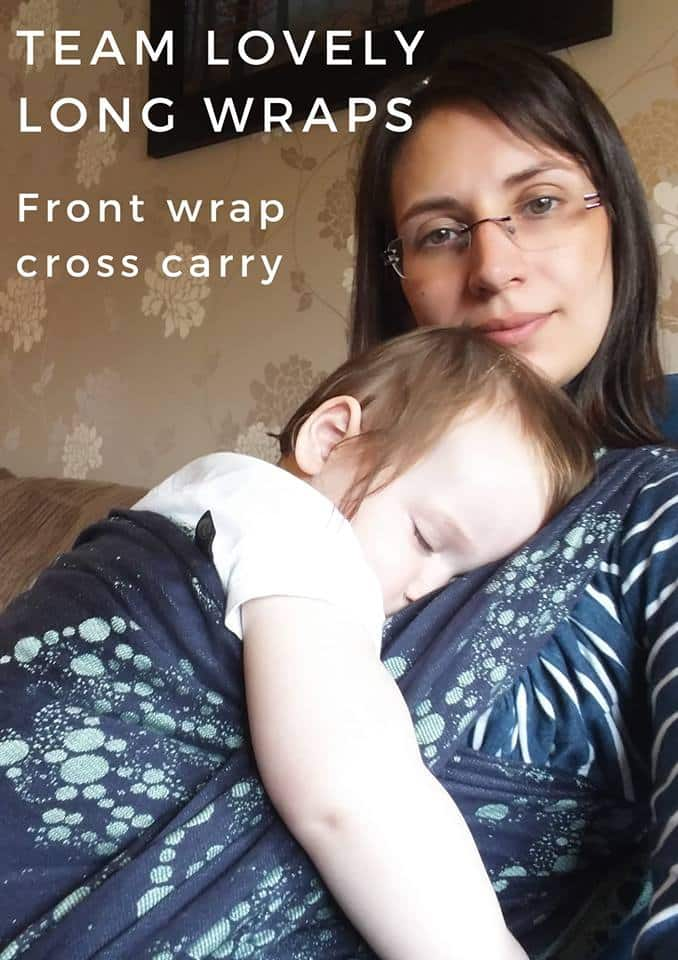 Elena breastfeeds in a long wrap