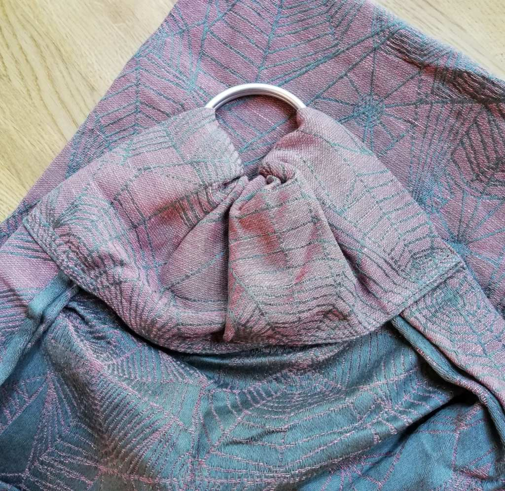 Ring sling with a Rose Pleat shoulder