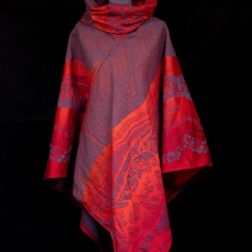 Red and grey poncho woven from organic cotton and lambswool merino with a hill design