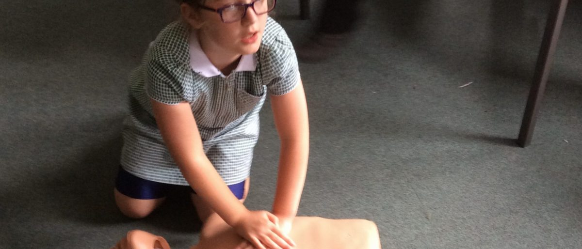 School Girl learning about resuscitation