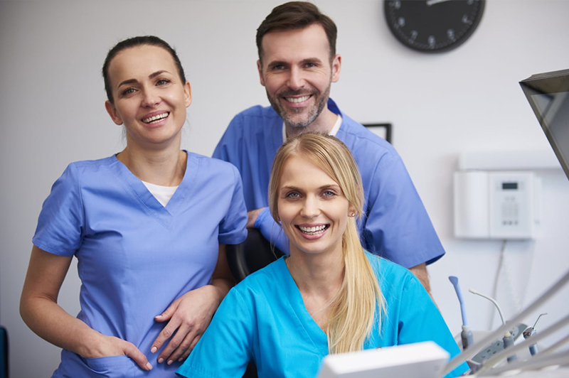 A group of doctors and nurses posing in the office