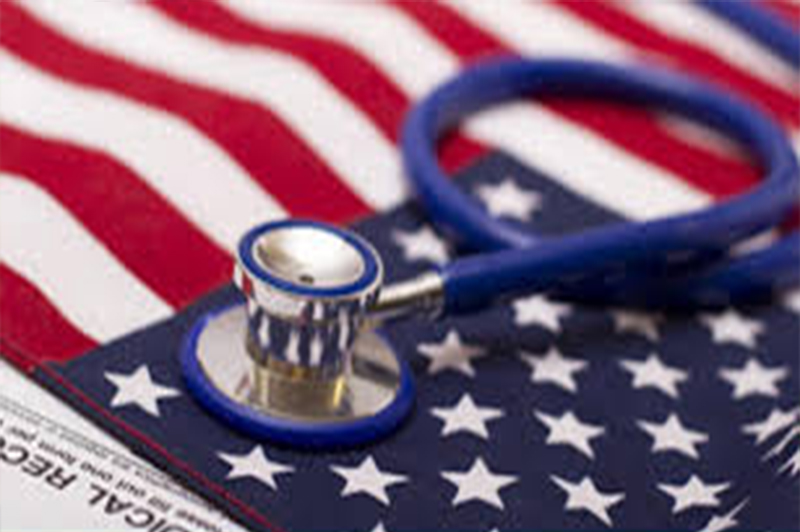 Stethoscope on top of an American Flag