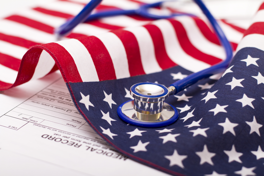 stethoscope on american flag and medical record papers