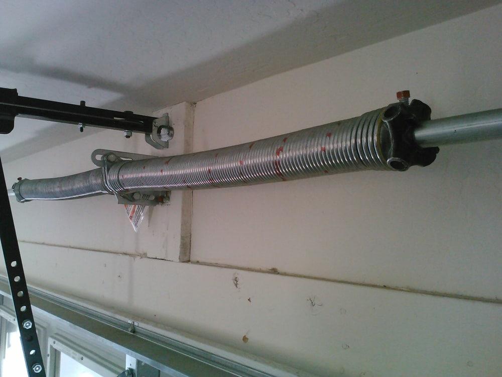 4 Steps to Replacing Broken Garage Door Springs - Overhead ... on Overhead Garage Door Spring Replacement  id=79290