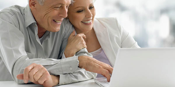 man and woman joyfully browse the internet