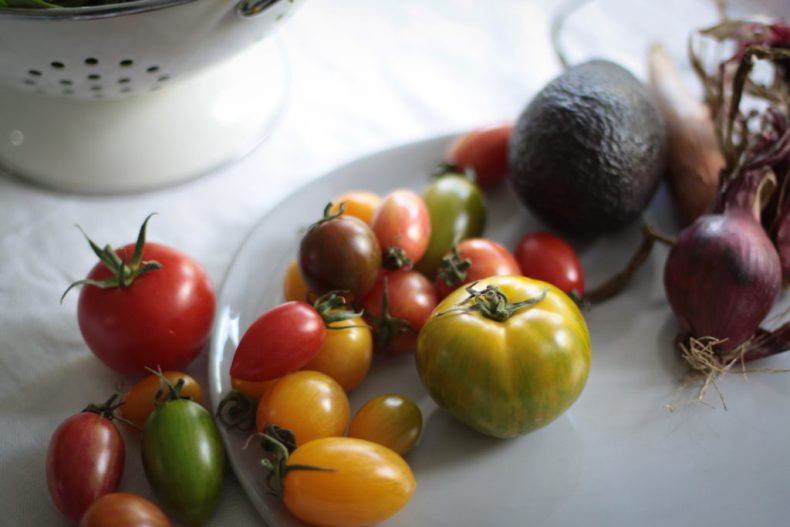 Collection of tomatoes for caprese salad
