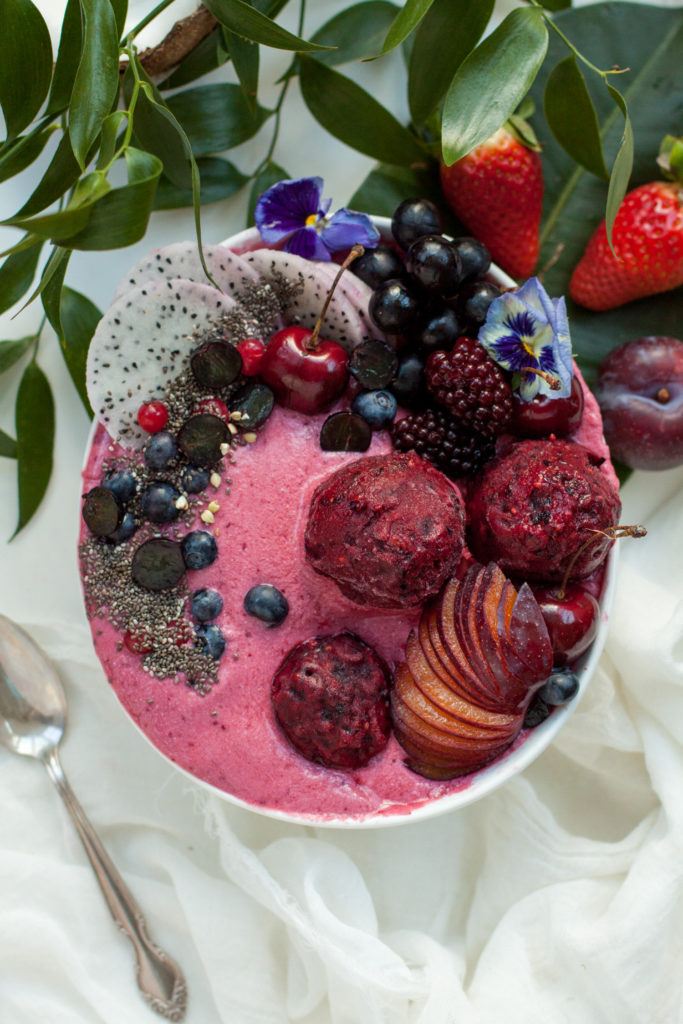 Tropical red smoothie bowl with vegan berry sorbet.