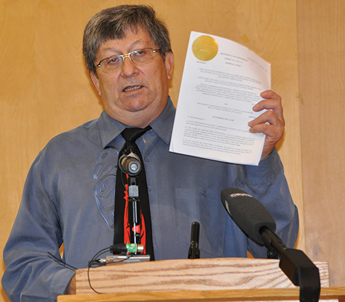 Chief Garry Feschuk holds the Statement of Claim filed on August 15, 2012.