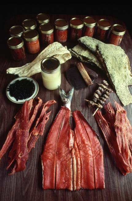 "Traditional marine foodstuffs of the Haida people, including dried and smoked salmon, seaweed, dried halibut, olican grease, dried clams, and a dish called ""kaaw,"" made of dried herring eggs on kelp. Photo by Dewitt Jones/Corbis"
