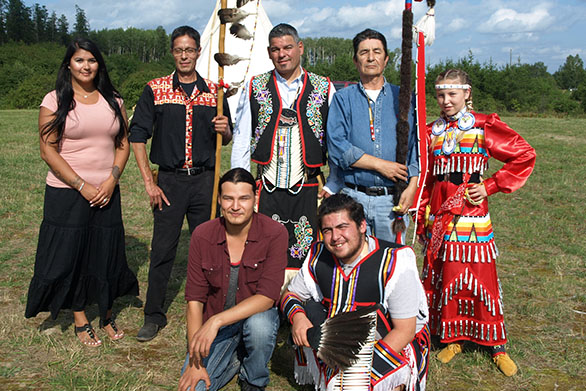 The Annual Mattagami First Nation Pow Wow in northern Ontario was established by local people to encourage culture and traditions in their community. Pictured during Mattagami's Pow Wow are some of the leaders, organizers and youth who make this event possible every year. From L-R are: Dana McKenzie, Pow Wow Coordinator; Mattagami FN Chief Chad Boissoneau, past Regional Chief Isadore Day, Chiefs Of Ontario; former Chief Walter Naveau, Mattagami FN and Mattagami FN Youth Dancer Tessa Thomas. In front are Mattagami FN member Nathan Naveau, Thunder Creek Drum Group and Max Worme, Lead Youth Male Dancer.