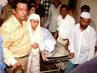 Ishrat Jahan's mother collects the body of her daughter. AFP