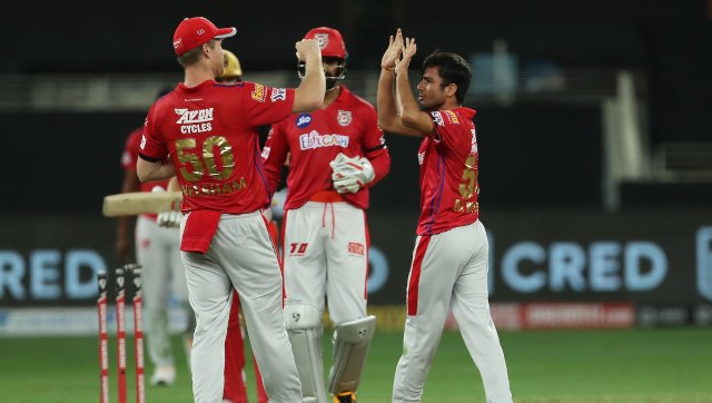 KXIP's Ravi Bishnoi celebrates the wicket of RCB's Aaron Finch. Image: Sportzpics for BCCI