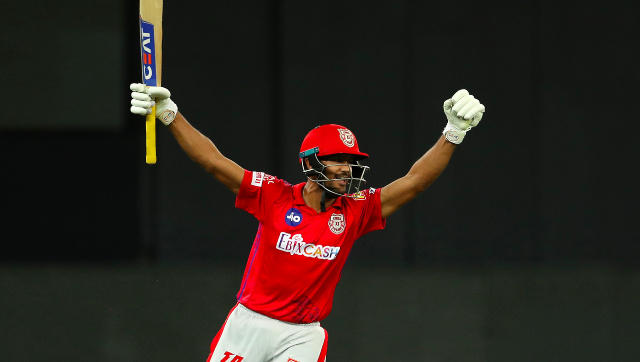 Mayank Agarwal celebrates after hitting the winning shot for KXIP in the second Super Over of the match against MI. Sportzpics