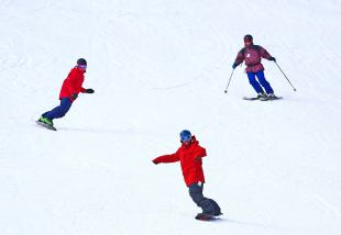 Skiers and boarders enjoy their first turns of the season today at Loveland Ski Area in Georgetown, Colo. (photo: Jack Dempsey/CSCUSA)