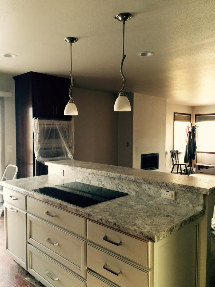New Kitchen Island with a Raised Snack Bar and Cook Top