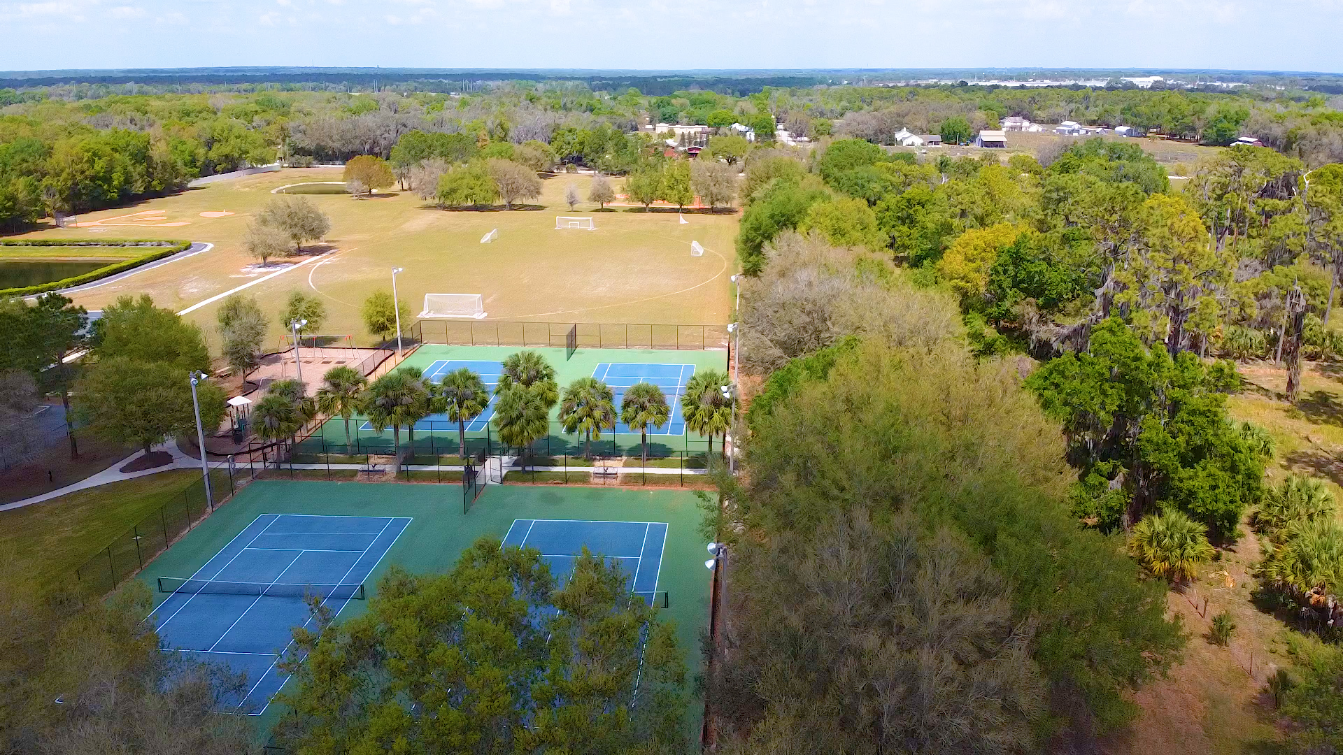 Drove view of the Fish Hawk Trails tennis courts and soccer fields
