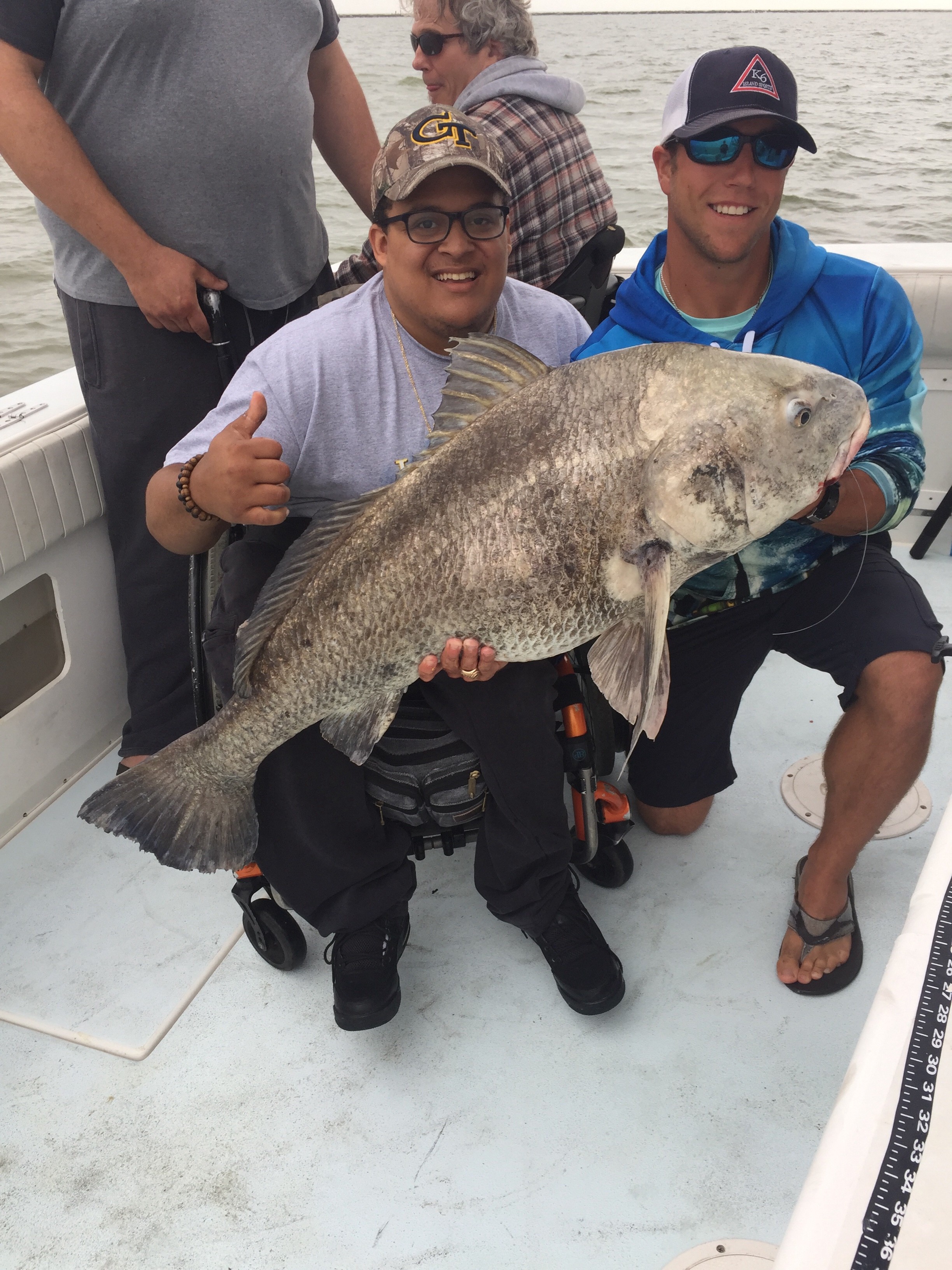 Three fishermen in Galveston, Texas Black Drum catch