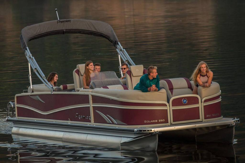 family on a premier pontoon boat