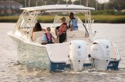 A family on a Grady White powered by Yamaha 300hp V6 outboards