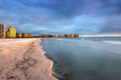 Sunset and clouds over the calm water of Tigertail Beach on Marco Island