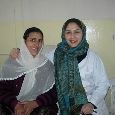 Dr. Jebran (right) with a recovering fistula patient following a successful repair surgery