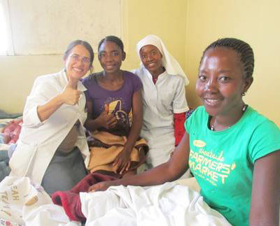 Dr. Priscila Cummings (pictured far left) in Kalukembe Hospital.