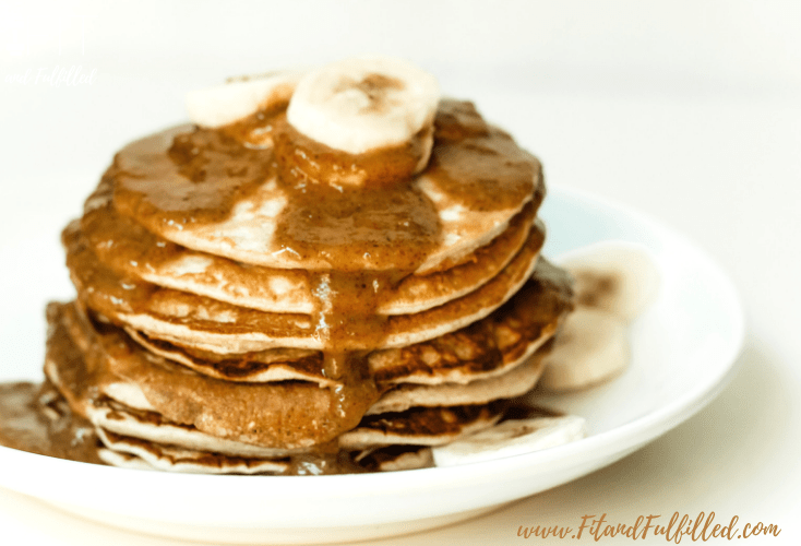 easy protein pancakes with almond butter syrup and bananas overhead view
