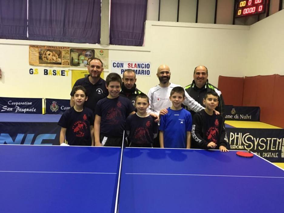 Ai due estremi Marco Dessì e Massimo Posadinu con i rispettivi compagni di squadra