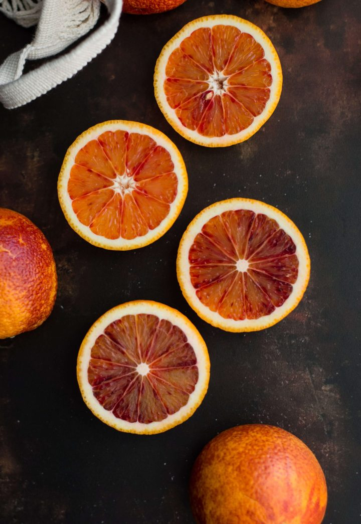 Blood oranges on dark background