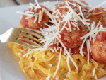 spaghetti squash with turkey meatballs on a white plate ready to eat