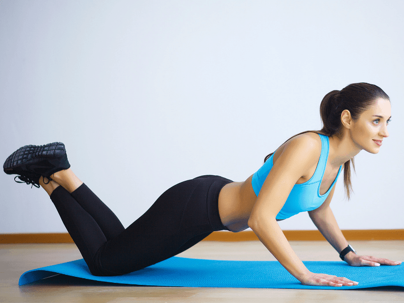 woman doing a modified plank on knees