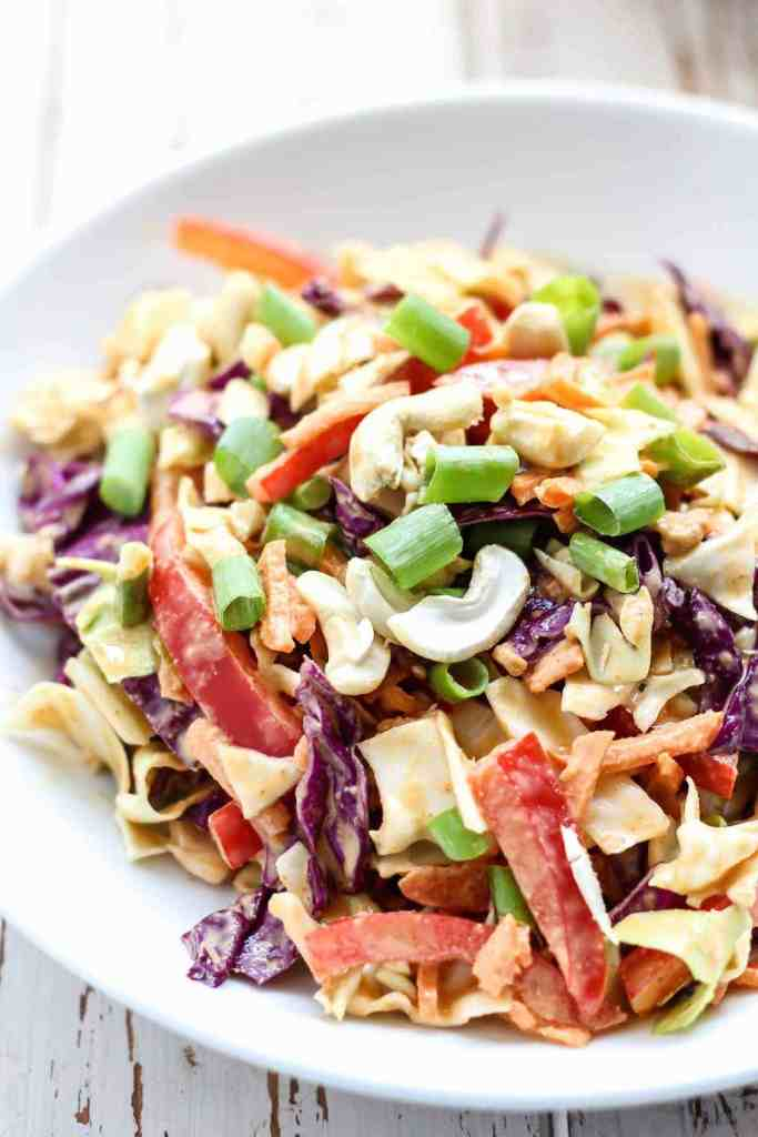 Throw some Asian flair into your coleslaw and make this Thai slaw with creamy cashew curry dressing. Flavorful, fun, and a great addition to any BBQ. Paleo and vegan-friendly.