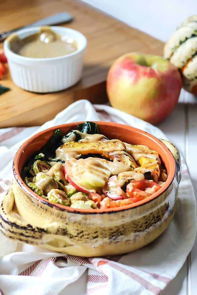 A Fall Harvest Power Bowl loaded with your fall favorites, topped off with a spiced maple tahini dressing! This bowl is vegan-friendly and can be made gluten-free with your choice of grain. Lots of healthy carbs and fats in this bowl plus fiber to keep you feeling full.