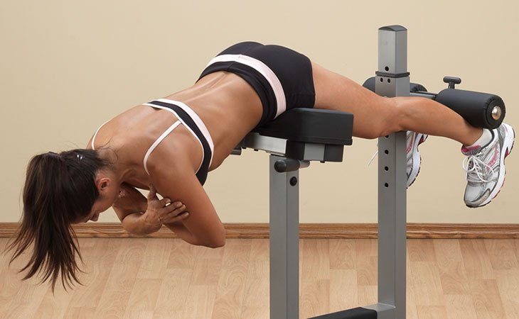 Woman Doing Back Extensions For Her Lower Back Workout Fitness