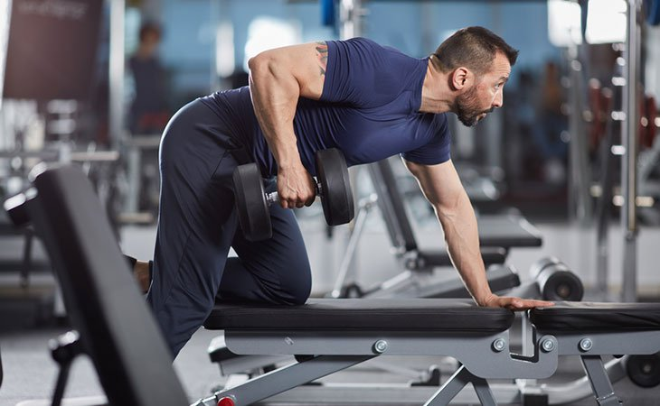 Man Working Out Dumbbell Row For Fitness
