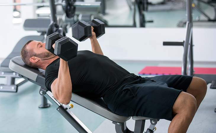 Man Doing A Low Incline Chest Fly Exercise