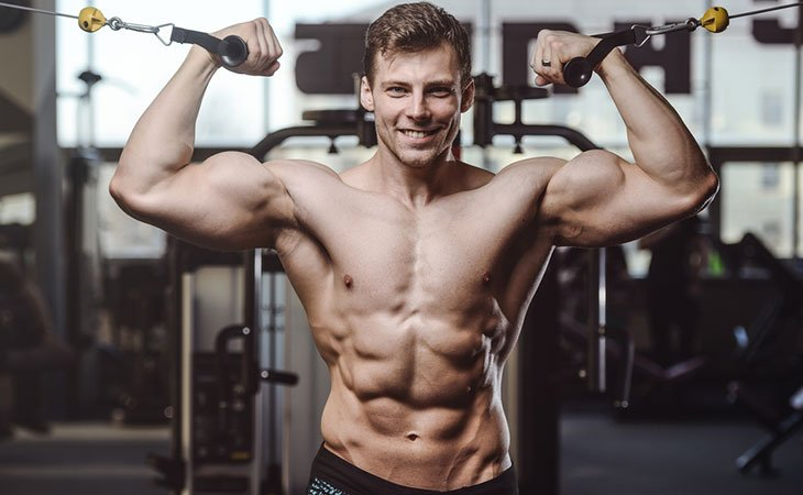 Man Doing A Overhead Cable Curl Exercise For Biceps