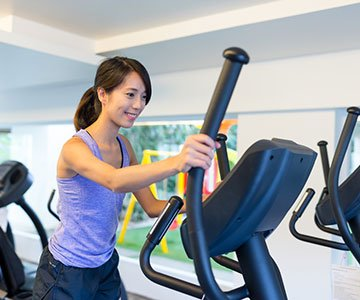 Woman Using Elliptical For Fitness