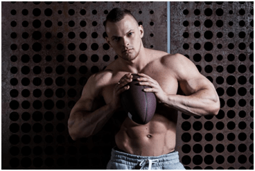 bodybuilder standing with a baseball