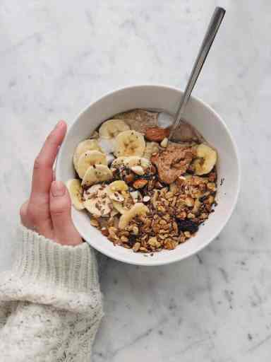 bowl of cereal with dried fruits for breakfast