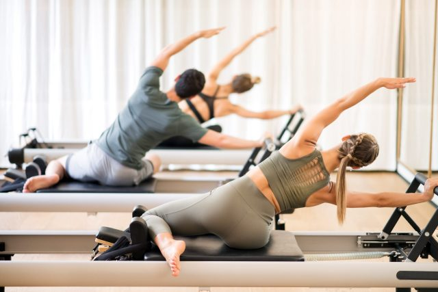 How to Use Live Fitness Classes to Grow your Fitness Business: image of a pilates fitness class.