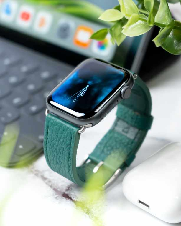Wearable tech: an image of an apple watch standing up right.