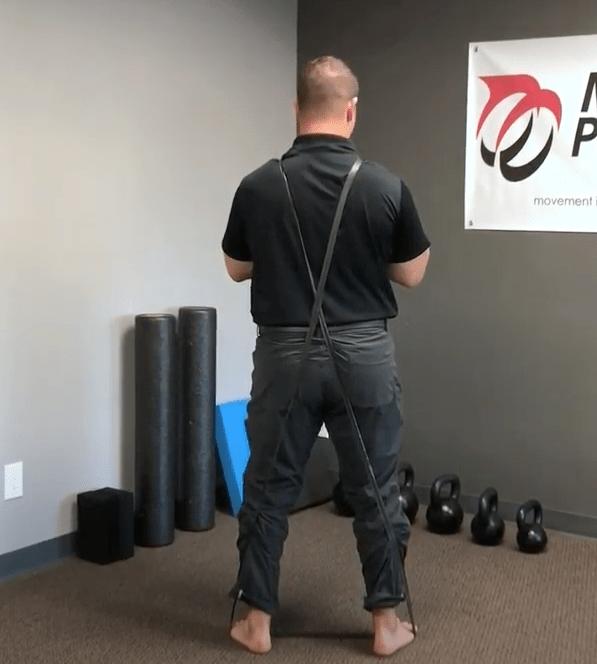Crossed Resistance Band Over Shoulder Hip Hinge