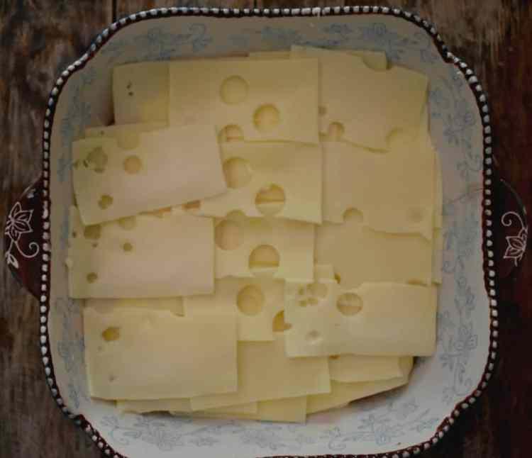 assembling of Keto Chicken Cordon Bleu casserole