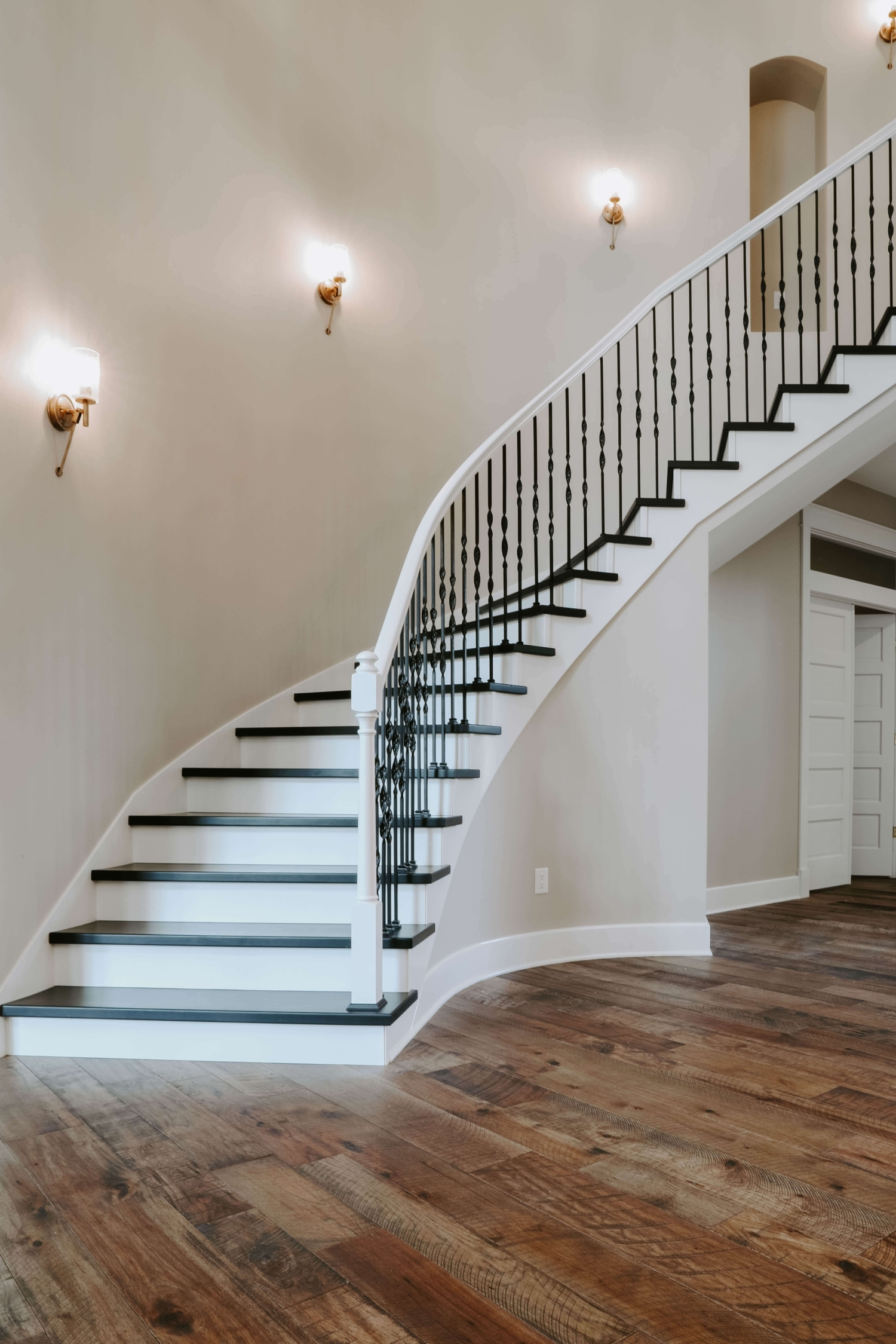 Fitts Industries Creating Stair Parts For Today S Stylish Home | Wood Handrail With Iron Balusters | Stairway | Wooden | Copper | Cast Iron | Landing